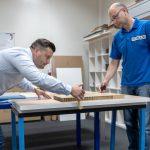 Рабочий на мебельной фабрике фото